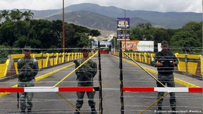 At least 37 killed in Prison riot in Venezuela.