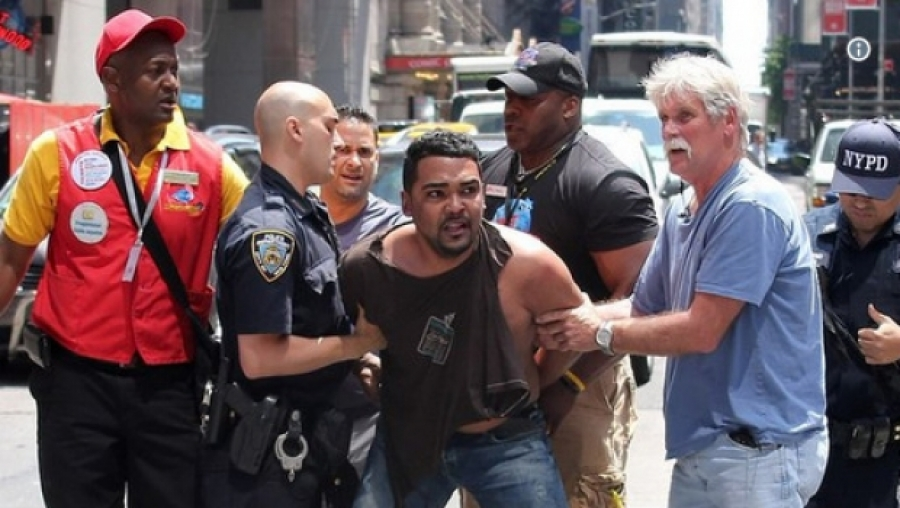 New York Police detains man after ramming car in pedstrain lane,killing 1,injuring 22.