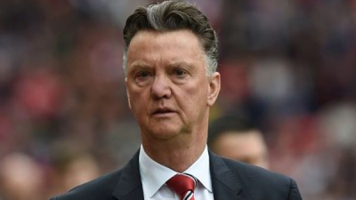 "Louis van Gaal says he was misunderstood when he said Manchester United are ""in the process"" of signing a striker."