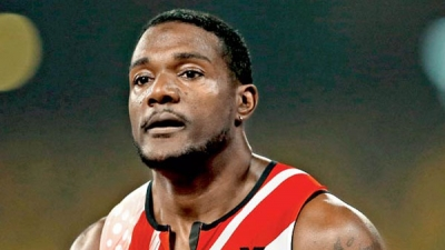 Justin Gatlin will lead a 130-strong US team at the World Championships in Beijing, with world silver medallist Nick Symmonds the notable absentee.