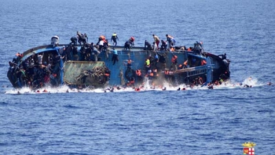 Armed men attack boat carrying migrants off Libya leaving four dead and fifteen missing.