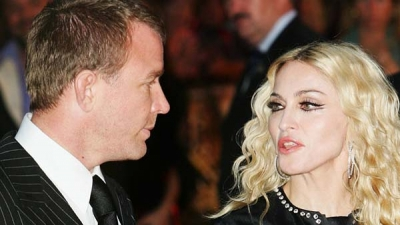 MADONNA , GUY RITCHIE  settle  legal dispute over custody of their 16-year-old son ROCCO.