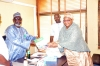 Hajiya Siddique Isa (right) presenting an NYSC book to Dr. Sanusi at the NFF secretariat on Wednesday